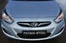 Накладки на передние фары (реснички) Hyundai Solaris седан 2010-2014 (l дорестайлинг)